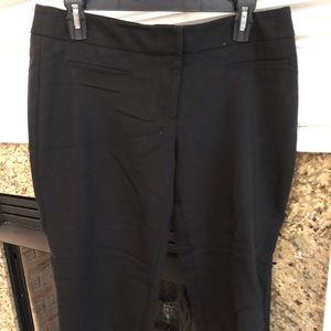 Women's black slacks.